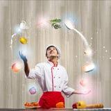 Cook przy kuchnią Zdjęcie Stock