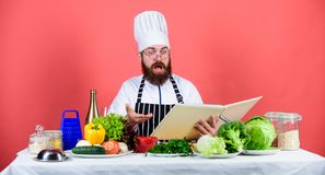 Cook read book recipes. Man learn recipe. Try something new. Cookery on my mind. Cooking skill. Book recipes. According. To recipe. Man bearded chef cooking stock photos