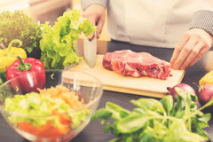 Cook is ready for raw meat preparation Royalty Free Stock Photo