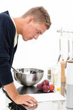 Cook with recipe Stock Photography