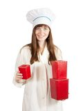 Cook with  red  packages Royalty Free Stock Images