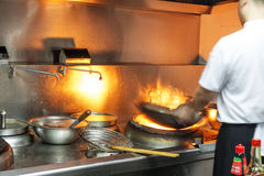 The cook in the restaurant kitchen work Royalty Free Stock Photos