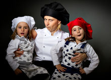 Cook restaurant team crazy faces Stock Image
