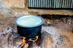 Cook rice. Old-fashioned cooking without electricity Stock Photo