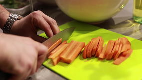 Cook`s hands preparing carrots on cutting board, selective focus. Cook`s hands preparing carrots on cutting board, vegetable salad, selective focus stock video footage