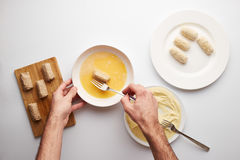 Cook's hands preparing croquettes royalty free stock photos