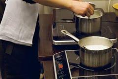 Cook`s hands preparing food Stock Photos