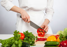 Cook's hands preparing salad Royalty Free Stock Images