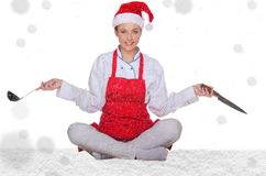 Cook in Santa hat, yoga, knives and snow Royalty Free Stock Images