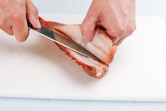 Cook separates fish fillet Royalty Free Stock Photos