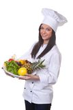 Cook serves a bowl of fruit and vegetables stock photo
