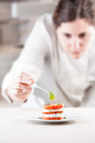 Cook serving tomato and mozzarella slices Royalty Free Stock Image