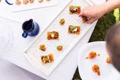 Cook serving vegetarian canapes Stock Images
