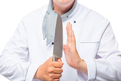 Cook and a sharp knife in his hands. Close up Royalty Free Stock Image
