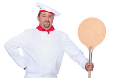 Cook with shovel for oven. Cook with wooden shovel for oven Royalty Free Stock Image