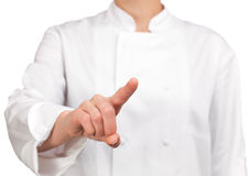 Cook showing or touching something finger Royalty Free Stock Photos