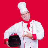 Cook shows in an empty baking pan Stock Photography