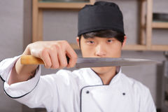 Cook shows sharp knife Royalty Free Stock Photography