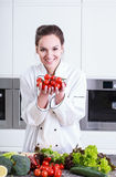 Cook shows small tomatoes Royalty Free Stock Photos
