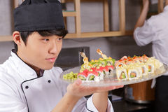Cook shows a sushi set Stock Photo