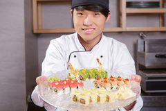 Cook shows a sushi set Stock Photography