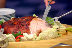 Cook sliced roasted meat at the party Royalty Free Stock Photography