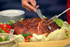 Cook sliced roasted meat at the party Stock Photography