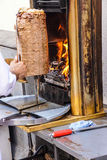 Cook slices shawarma Stock Photography