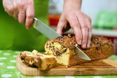 Cook slicing bun Stock Image