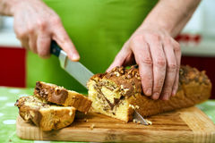 Cook slicing bun Royalty Free Stock Photography