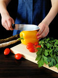 A cook is slicing vegetables. With a sharp knife stock images