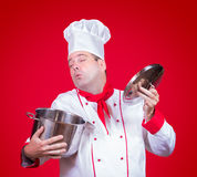 Cook smell the open pot Stock Images