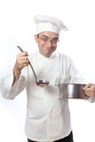 Cook with spoon and pot. Over white Royalty Free Stock Photo