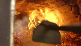 Cook spreading fire poker. Old Ukrainian authentic oven. stock footage