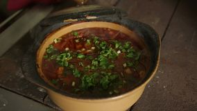 Cook sprinkles ready meal seasonings. Traditional Ukrainian borsch dish. stock video footage