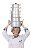 Cook with stack of pots Royalty Free Stock Photos