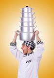 Cook with stack of pots on white Royalty Free Stock Image