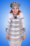 Cook with stack of pots on white Stock Photos