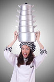 Cook with stack of pots on white Stock Photography