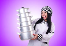 The cook with stack of pots on white Royalty Free Stock Photos