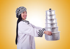The cook with stack of pots on white Stock Photo