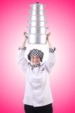 The cook with stack of pots on white Royalty Free Stock Photo