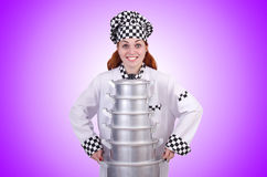 The cook with stack of pots on white Stock Photography