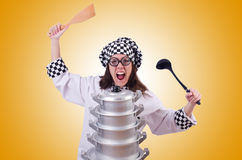 The cook with stack of pots on white Stock Photos