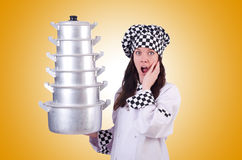 The cook with stack of pots on white Royalty Free Stock Images
