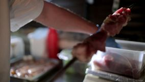 Cook strung pieces of meat on the skewer stock footage