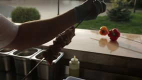 Cook strung pieces of meat on the skewer on the kitchen stock footage