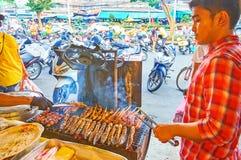 The cook of Talad Saphan Phut market, Bangkok, Thailand