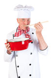 Cook taste the food Stock Photography