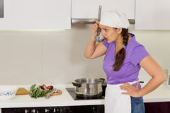 Cook tasting the food she is cooking Royalty Free Stock Photography